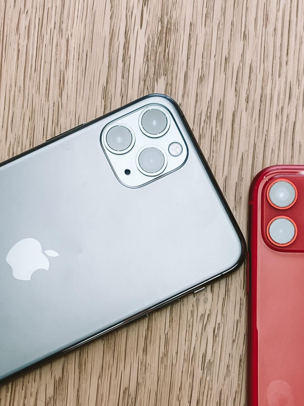 silver iPhone 11 on brown surface